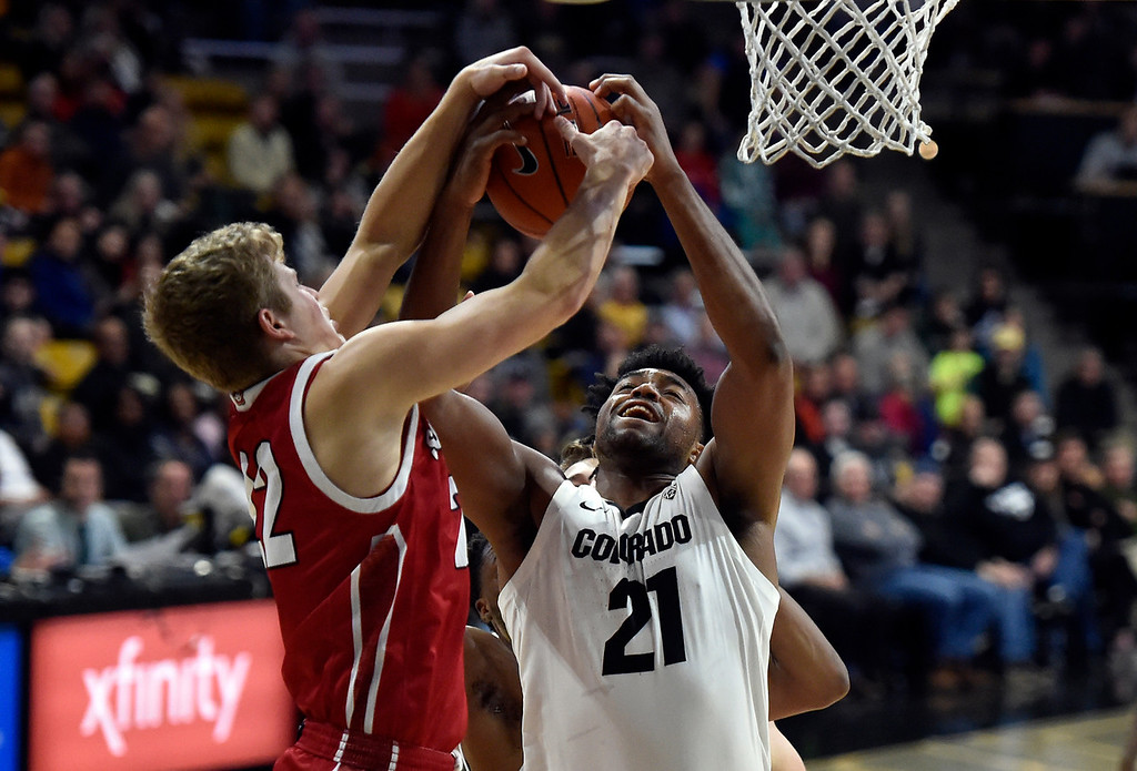 . BOULDER, CO - DECEMBER 4, 2018: University of Colorado\'s Evan Battey snags a rebound over Tyler Peterson during a NCAA game against the University of South Dakota on Tuesday at the Coors Event Center on the CU campus in Boulder. More photos: Buffzone.com (Photo by Jeremy Papasso/Staff Photographer)