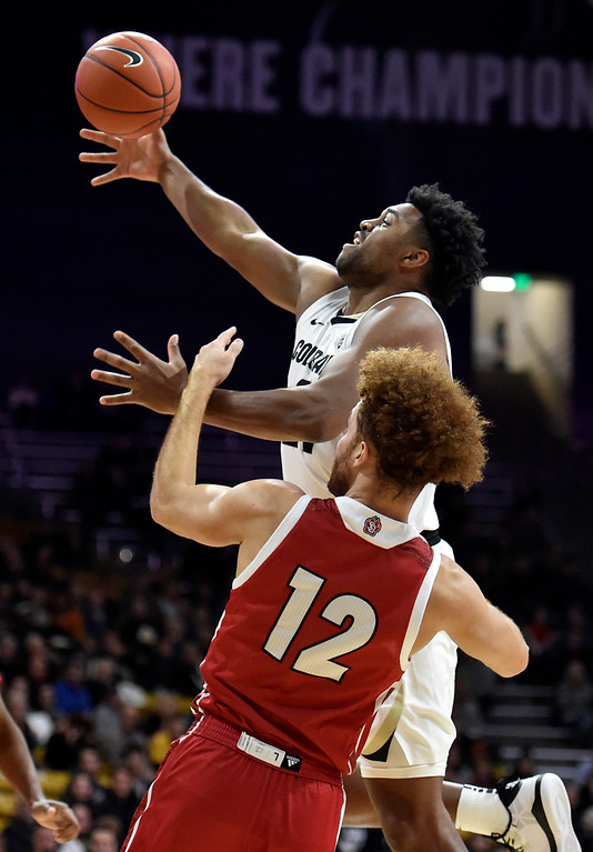 . BOULDER, CO - DECEMBER 4, 2018: University of Colorado\'s Evan Battey grabs a rebound during a NCAA game against the University of South Dakota on Tuesday at the Coors Event Center on the CU campus in Boulder. More photos: Buffzone.com (Photo by Jeremy Papasso/Staff Photographer)