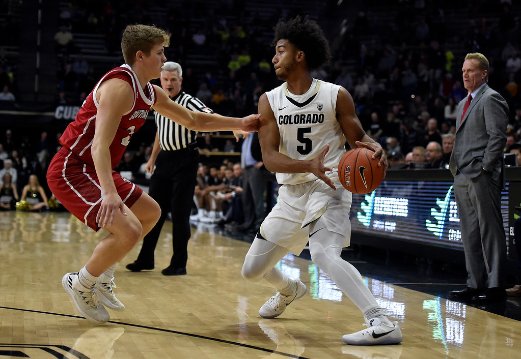 . BOULDER, CO - DECEMBER 4, 2018: University of Colorado\'s D\'Shawn Schwartz drives towards the hoop past Tyler Peterson during a NCAA game against the University of South Dakota on Tuesday at the Coors Event Center on the CU campus in Boulder. More photos: Buffzone.com (Photo by Jeremy Papasso/Staff Photographer)