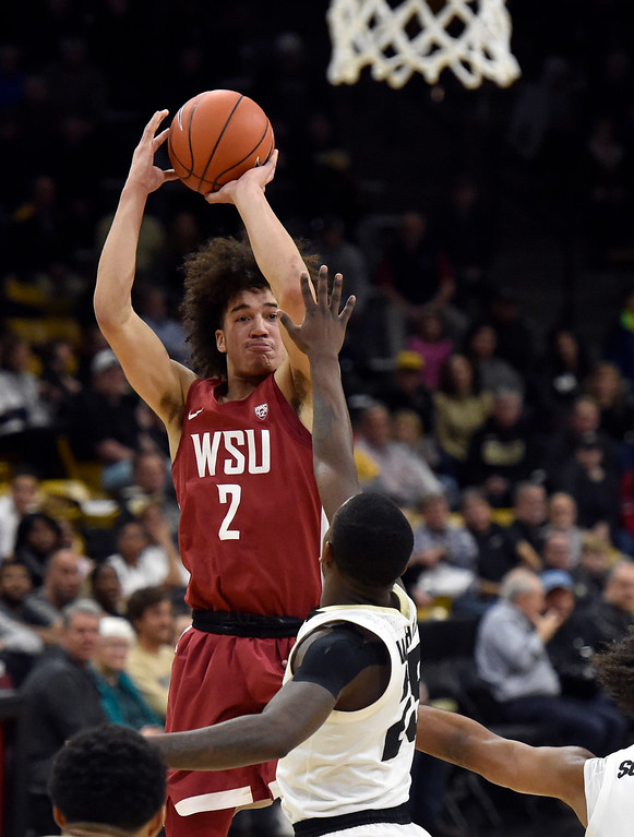 . BOULDER, CO - JANUARY 10, 2019: Washington State\'s CJ Elleby takes a shot over McKinley Wright IV during a NCAA Pac 12 basketball game against Colorado on Thursday at the Coors Event Center on the CU campus in Boulder. More photos: Buffzone.com (Photo by Jeremy Papasso/Staff Photographer)