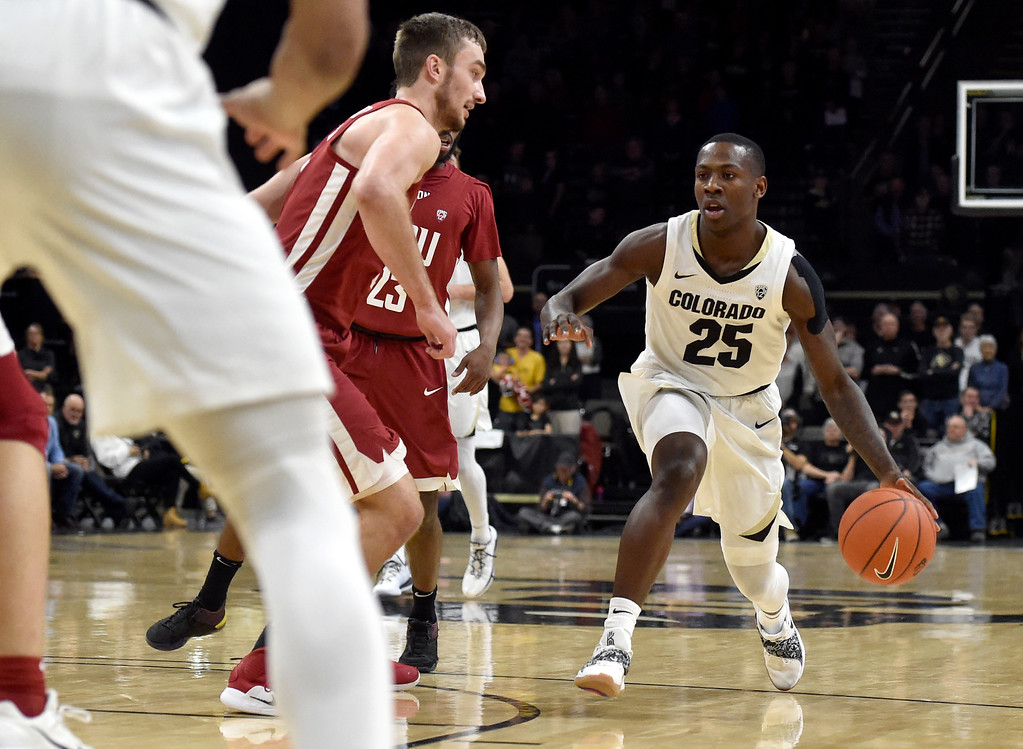 . BOULDER, CO - JANUARY 10, 2019: University of Colorado\'s McKinley Wright IV dribbles towards the hoop during a NCAA Pac 12 basketball game against Washington State  on Thursday at the Coors Event Center on the CU campus in Boulder. More photos: Buffzone.com (Photo by Jeremy Papasso/Staff Photographer)