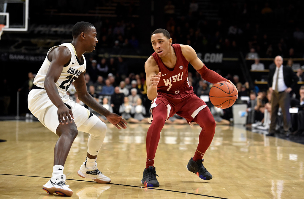 . BOULDER, CO - JANUARY 10, 2019: Washington State\'s Jervae Robinson dribbles down court past McKinley Wright IV during a NCAA Pac 12 basketball game against Colorado on Thursday at the Coors Event Center on the CU campus in Boulder. More photos: Buffzone.com (Photo by Jeremy Papasso/Staff Photographer)