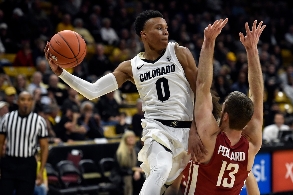 . BOULDER, CO - JANUARY 10, 2019: University of Colorado\'s Shane Gatling passes the ball over the head of Jeff Pollard during a NCAA Pac 12 basketball game against Washington State  on Thursday at the Coors Event Center on the CU campus in Boulder. More photos: Buffzone.com (Photo by Jeremy Papasso/Staff Photographer)