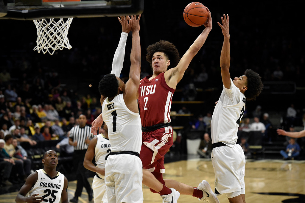 . BOULDER, CO - JANUARY 10, 2019: Washington State\'s CJ Elleby goes for a dunk over Tyler Bey during a NCAA Pac 12 basketball game against Colorado on Thursday at the Coors Event Center on the CU campus in Boulder. More photos: Buffzone.com (Photo by Jeremy Papasso/Staff Photographer)