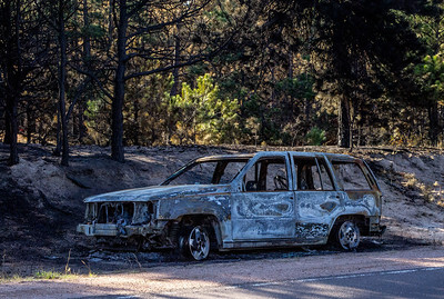 Burnt car along side Black Forest road.