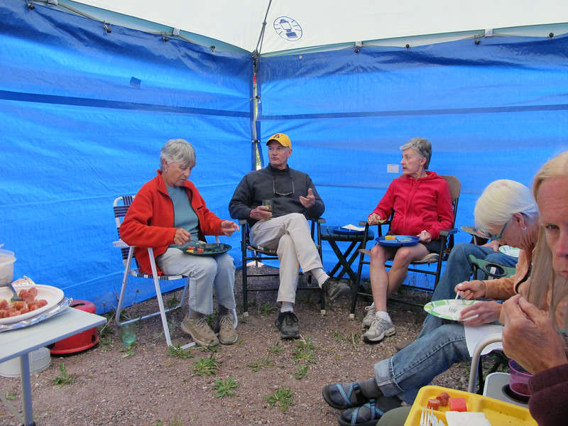 Pat, Jim T, Alice, Jerrie and Kathi partaking in Happy Hour & Pot Luck under the 10x10 canopies.