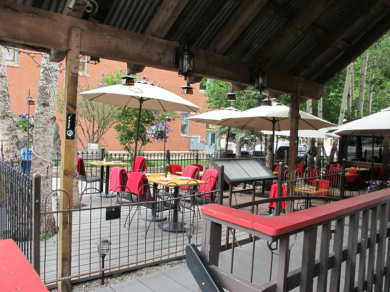 Downtown Telluride restaurant outdoor patio. Those are blankets on the chairs. How thoughtful of them. :)