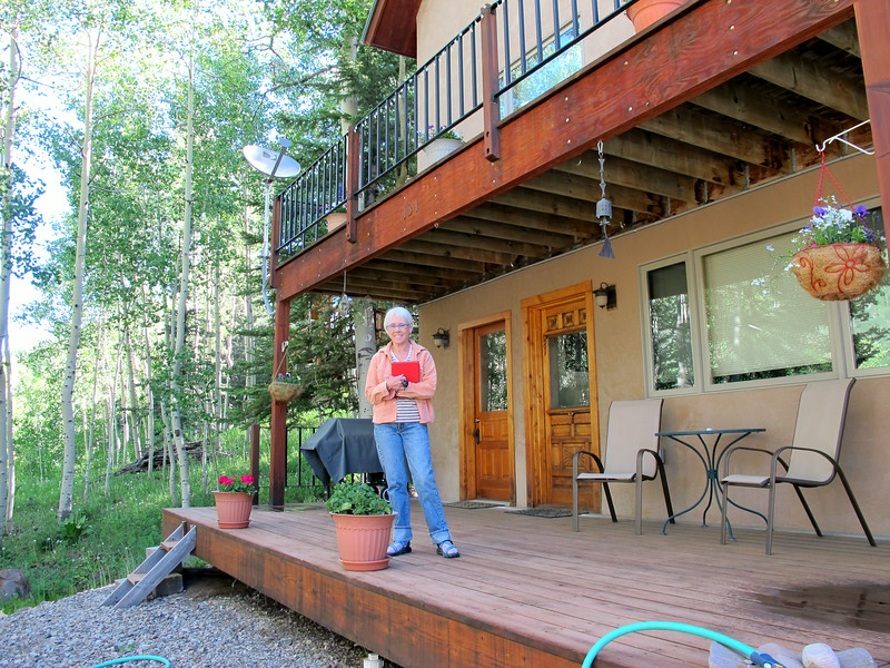Jerrie, our Rally Host, standing on her Rico CO porch.