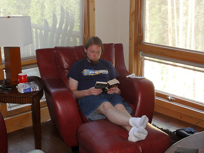Jeff reading in the Summit View condo at Winter Park.