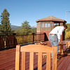 Joel putting together the outside table and chairs on our deck