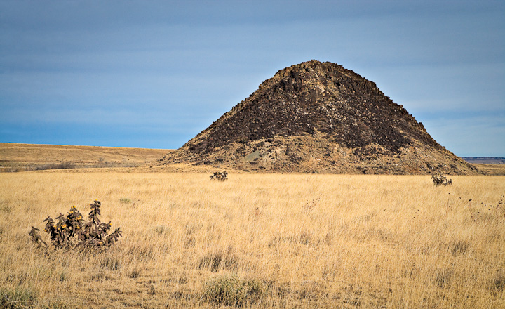 "Huerfano Butte - volcanic gabbro plug, Tertiary Along I-25, 10 miles north of Walsenburg Named ""El Huerfano"", the orphan by early Spaniards. Served as a landmark for early settlers The Fremont expedition photographed this butte on the way to California in 1853"