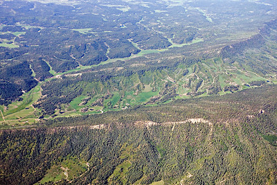 Aerial view of Texas Creek - Pictured Cliffs & Mesaverde outcrop Fruitland Formation coalbed methane well sites are visible toward the top. Upper Cretaceous - Northern San Juan Basin - view south