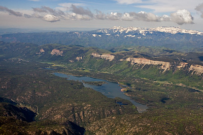 Aerial view of the Hermosa Cliffs and Animas River Valley, north of Durango, view south The snow covered La Plata Mountains are on the horizon. Hwy 550 traverses the base of the cliffs.  Hermosa Formation limestones, Pennsylvanian, form the cliffs.  This valley contained about 2000 feet of glacial ice that nearly reached the top of the cliffs several times during the Pleistocene  Electra Lake lies on PreCambrian, 1.4 - 1.8 billion year, gneiss and gabbro.