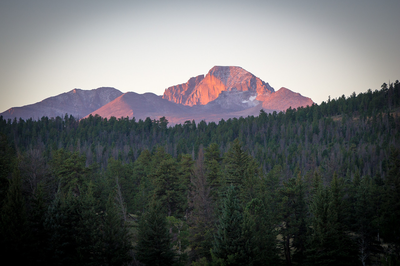 Long's peak is the tallest mountain in RMNP standing at 14,255 feet.  The glow from morning sun is shining on the peak.