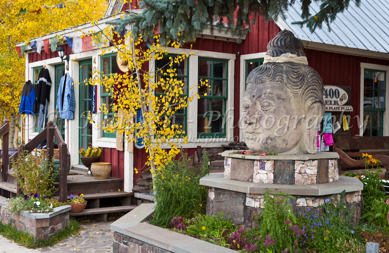 A shop with historical Victorian architecture and buddha head in Crested Butte, Colorado, USA, America.