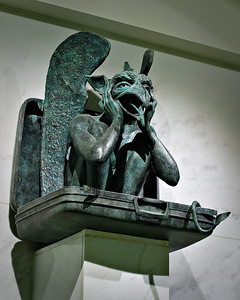 """Notre Denver"" - cast bronze by Terry Allen, 1994 Historically, gargoyles are placed on buildings to protect the site. At DIA, there a two that ensure baggage will arrive safely."