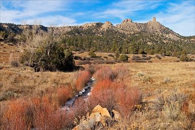 Chimney Rock - Fall - San Juan Basin - Colorado  Upper Cretaceous Pictured Cliffs Sandstone caps the ridgline Lewis Shale is seen on the slopes