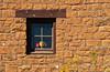 Adobe window with flowers at Mesa Verde National Park, Colorado, USA, America.