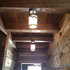 Lights in hallway from mudroom into house.