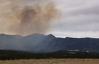 Smoke over the Air Force Academy.  The AFA Chapel is in the background on the right.