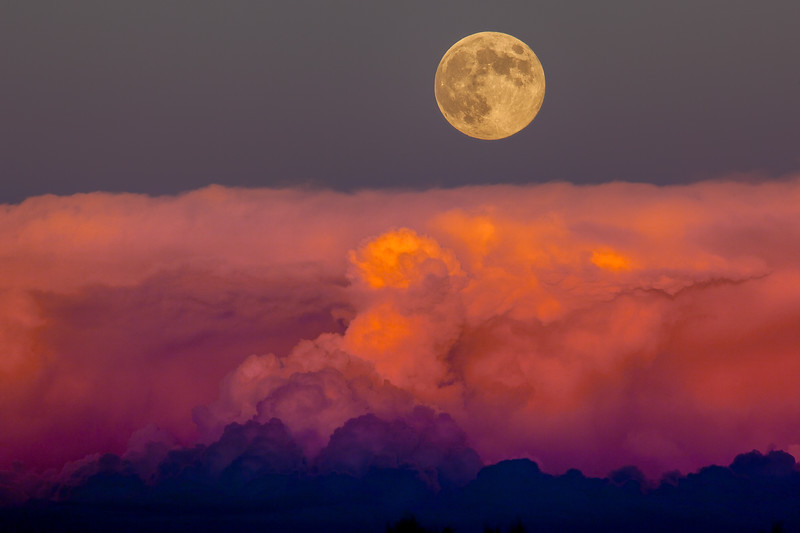 """Harvest Moon Rising Above Storm Clouds"""