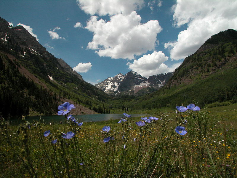 The Maroon Bells.  Two peaks in the Elk Mountains:  Maroon Peak (14,156') and North Maroon Peak (14,014').   Maroon Bells-Snowmass Wilderness of White River National Forest.   Twelve miles southwest of Aspen, Colorado.