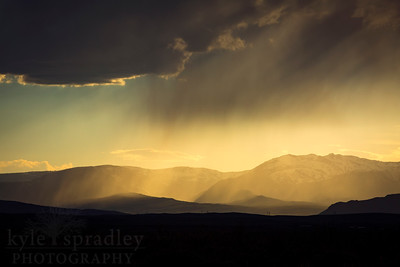 A summer sunset mixed with storm clouds along the Park Range in North Park's Walden, Colorado.   Photo by Kyle Spradley | © Kyle Spradley Photography | www.kspradleyphoto.com