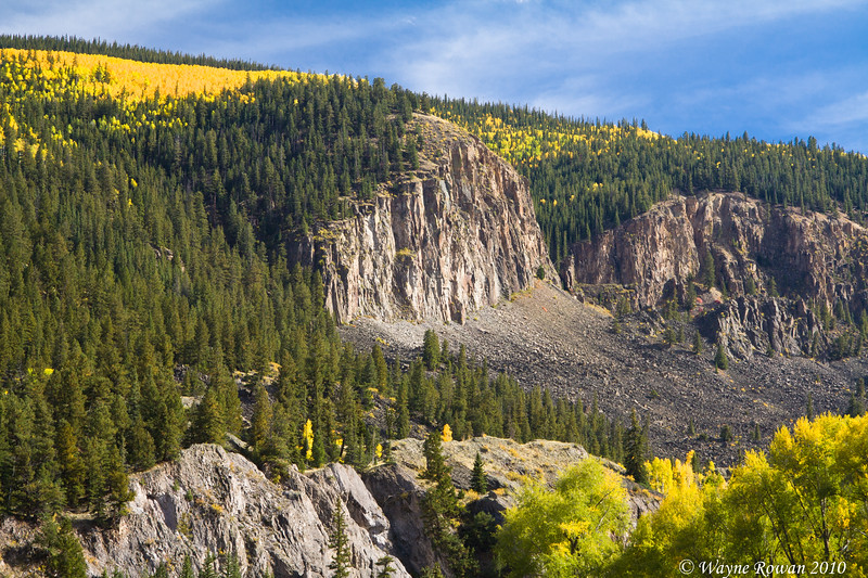 Rugged Cliff with Yellow Aspens