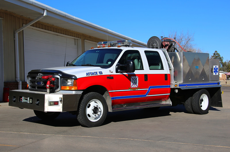 Attack 52<br /> 2000 Ford F-550 4×4 450 Gallons / 250 GPM with 15 gallons of foam and a bumper mounted turret.  Refurbished in 2013 by the department shops.