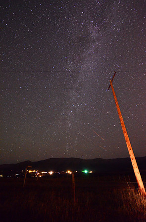 Another view of the Milky Way as seen from a field near Steamboat Springs CO.  One Perseid Meteor passing by just above two aircraft trails...