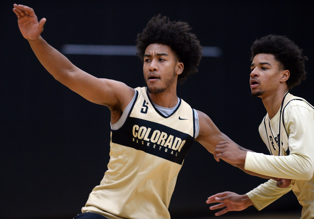 . BOULDER, CO: University of Colorado\'s D\'Shawn Schwartz, left,   during the first practice for the CU men\'s team on October 2, 2018. ((Photo by Cliff Grassmick/Staff Photographer)