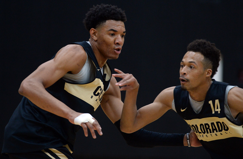 . BOULDER, CO: University of Colorado\'s  Tyler Bey, left, and Deleon Brown, run drills during the first practice for the CU men\'s team on October 2, 2018. ((Photo by Cliff Grassmick/Staff Photographer)