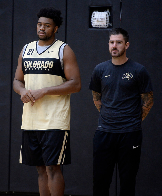. BOULDER, CO: University of Colorado\'s Evan Battey, left, with volunteer coach and former player, Nate Tomlinson,   during the first practice for the CU men\'s team on October 2, 2018. ((Photo by Cliff Grassmick/Staff Photographer)