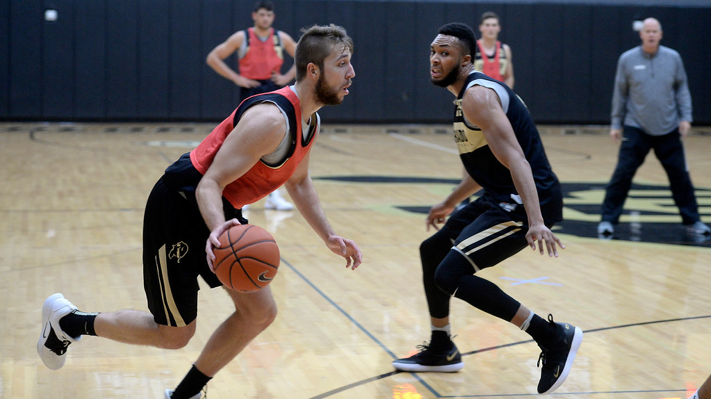 . BOULDER, CO: University of Colorado\'s Lucas Siewert, left, drives on Dallas Walton  during the first practice for the CU men\'s team on October 2, 2018. ((Photo by Cliff Grassmick/Staff Photographer)