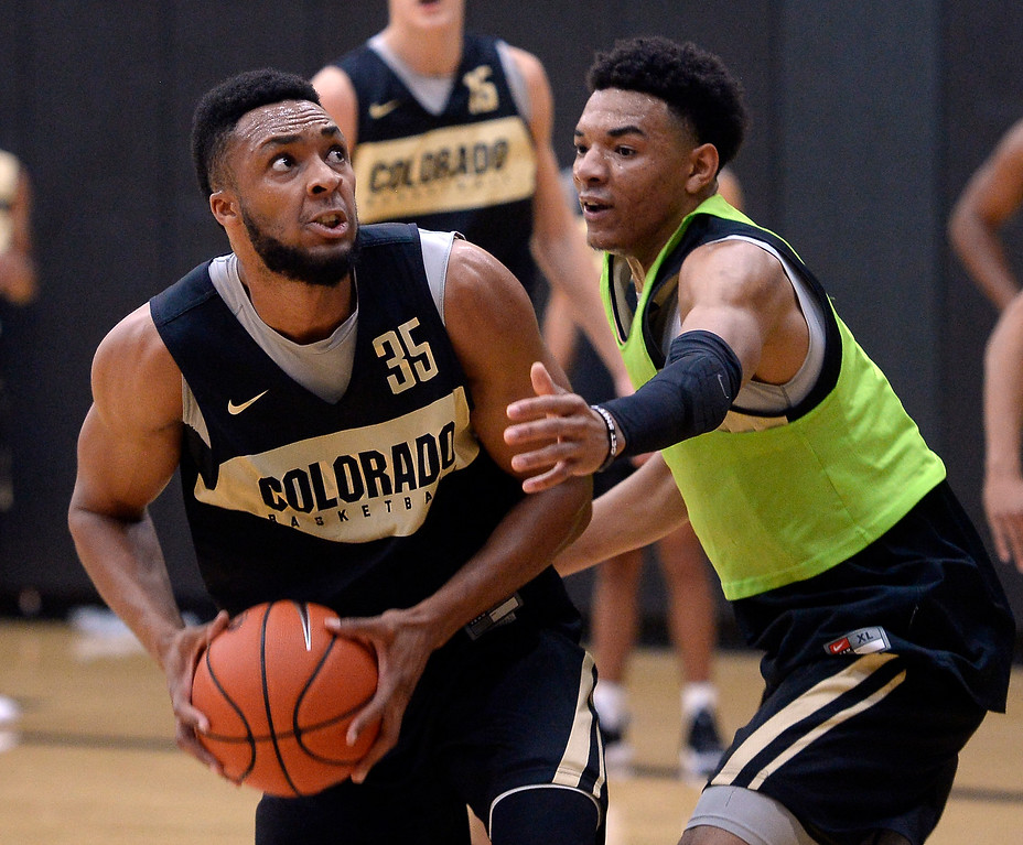 . BOULDER, CO: University of Colorado\'s  Dallas Walton, left, goes to the basket on Tyler Bey during the first practice for the CU men\'s team on October 2, 2018. ((Photo by Cliff Grassmick/Staff Photographer)