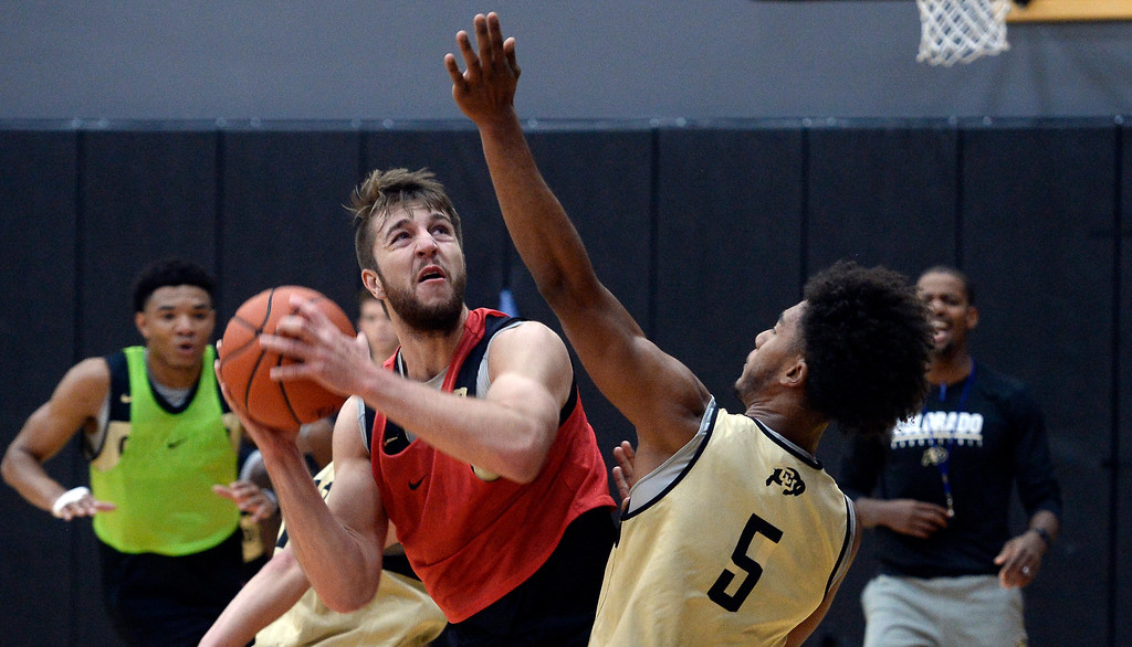. BOULDER, CO: University of Colorado\'s  Lucas Siewert, left, drives on D\'Shawn Schwartz  during the first practice for the CU men\'s team on October 2, 2018. ((Photo by Cliff Grassmick/Staff Photographer)