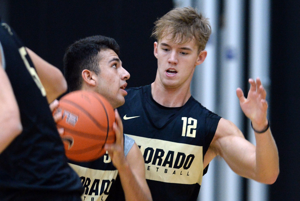 . BOULDER, CO: University of Colorado\'s Benan Ersek, left, drives on AJ Martinka, during the first practice for the CU men\'s team on October 2, 2018. ((Photo by Cliff Grassmick/Staff Photographer)