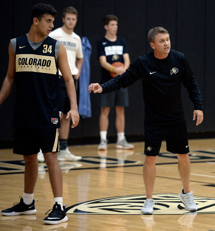 . BOULDER, CO: University of Colorado\'s  Benan Ersek, left and assistant coach, Mike Rohn, during the first practice for the CU men\'s team on October 2, 2018. ((Photo by Cliff Grassmick/Staff Photographer)