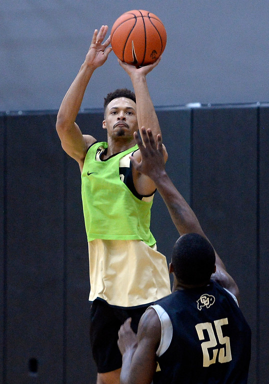 . BOULDER, CO: University of Colorado\'s  Deleon Brown shoots over McKinley Wright, IV,   during the first practice for the CU men\'s team on October 2, 2018. ((Photo by Cliff Grassmick/Staff Photographer)
