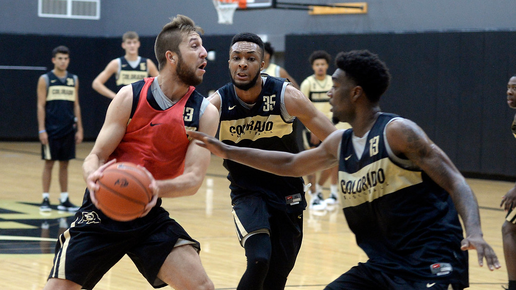 . BOULDER, CO: University of Colorado\'s  Lucas Siewert, left, drives on Dallas Walton and Namon Wright,  during the first practice for the CU men\'s team on October 2, 2018. ((Photo by Cliff Grassmick/Staff Photographer)