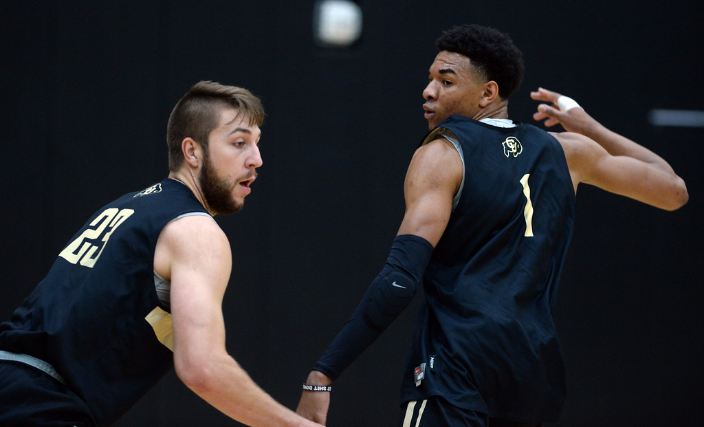 . BOULDER, CO: University of Colorado\'s Luca Siewart, left and Tyler Bey, during drills  during the first practice for the CU men\'s team on October 2, 2018. ((Photo by Cliff Grassmick/Staff Photographer)