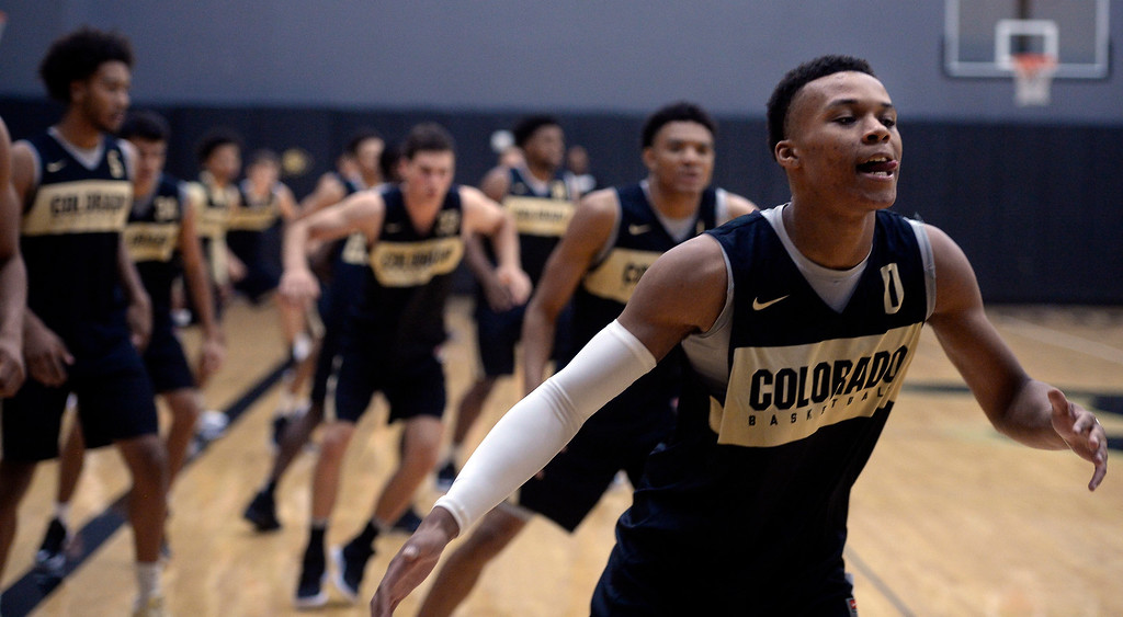 . BOULDER, CO: University of Colorado\'s Shane Gatling, right, warms up  during the first practice for the CU men\'s team on October 2, 2018. ((Photo by Cliff Grassmick/Staff Photographer)