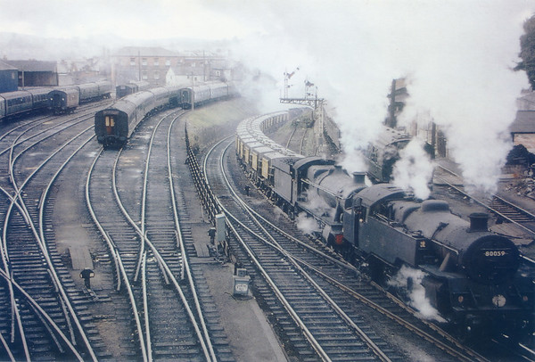 80059 pilots 6963 Throwley Hal past Exeter carriage sidings 28th September 1963