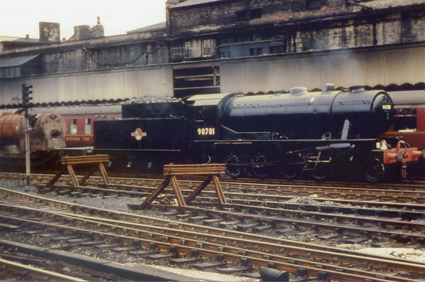90701 ex works condition Manchester Victoria hauling a unknown boiler WD 2-8-0
