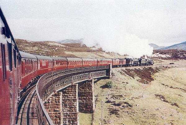 44956 is lead by BR std 73048 leaving Rannoch with the 7 30pm Kings Cross to Mallaig sleeper service 20th May 1961