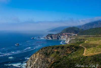 Part of California's Big Sur coastline with Bixby Creek's Bridge in the distance.