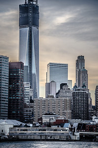 Freedom Tower stands tall as the sunset reflects a beautiful back drop.