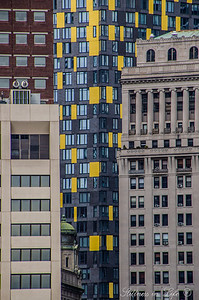 As we were flying by on a helicopter tour of New York's harbour these buildings caught my I so I quickly snapped this shot. The varying textures, colours, and periods of these buildings struck me. I found it interesting that they were so near to each other as different as they are, contrast and enhance each others personality, bring interest to the imagination, and remain timelessly symbolic....I suppose a bit like their inhabitants!