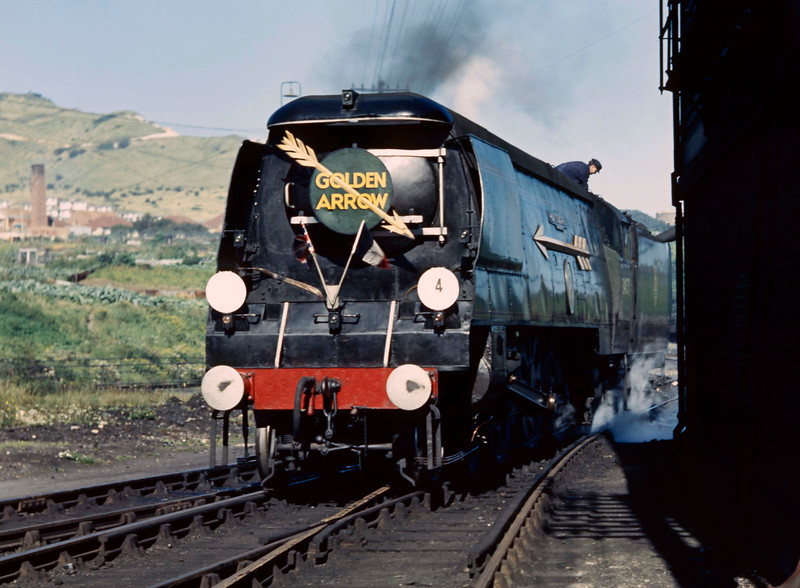 Golden Arrow locomotive, identified as Battle of Britain pacific 34085 501Squadron, being watered at Folkestone Junction.  The date is uncertain but most likely Summer 1959 when shots of the same locomotive on the turntable were taken by both my father and myself. This is a cropped version of the earlier upload.
