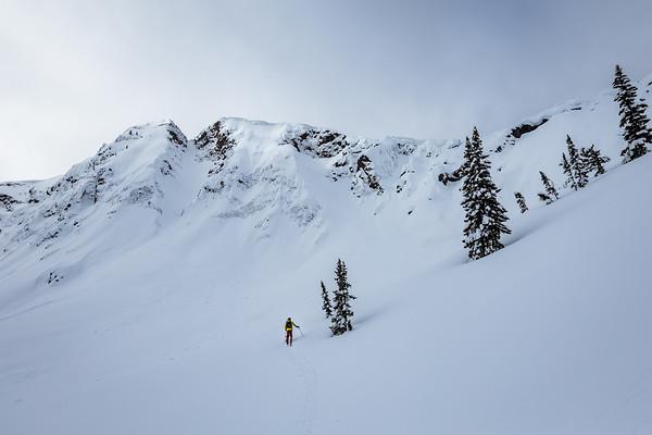 Sawyer Thomas skiining up Republic Peak. For John Colter Project.